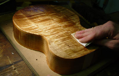 applying finish to back of baritone ukulele