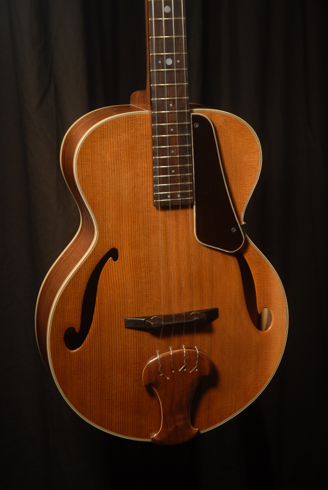 front view of the body of michael mccarten's archtop baritone ukulele model