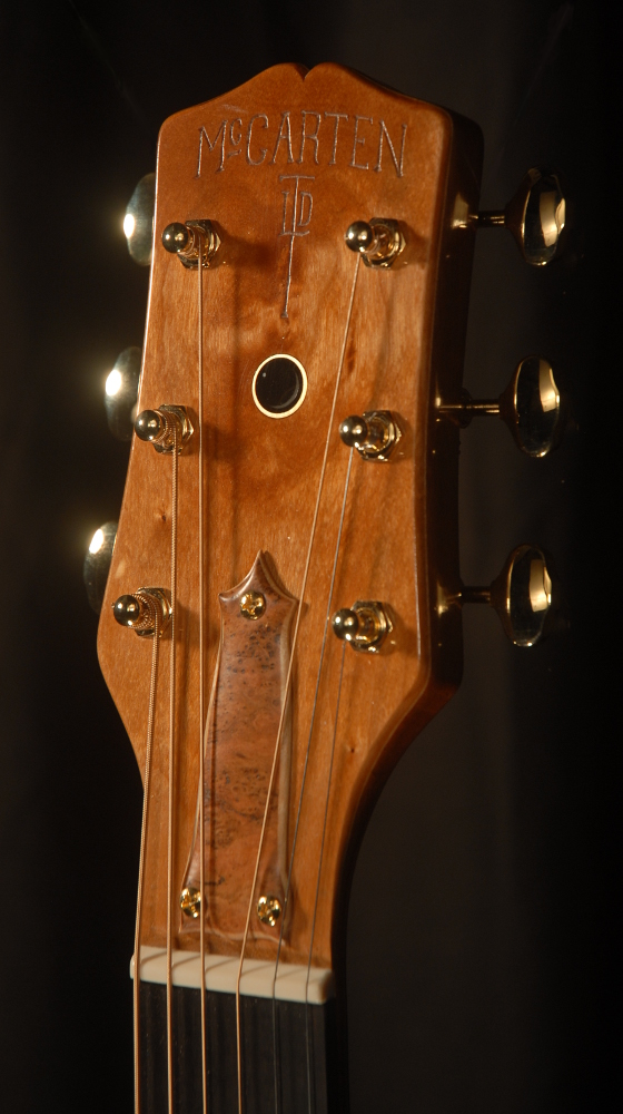 front view of the headstock of michael mccarten's 000-12 flat top guitar model