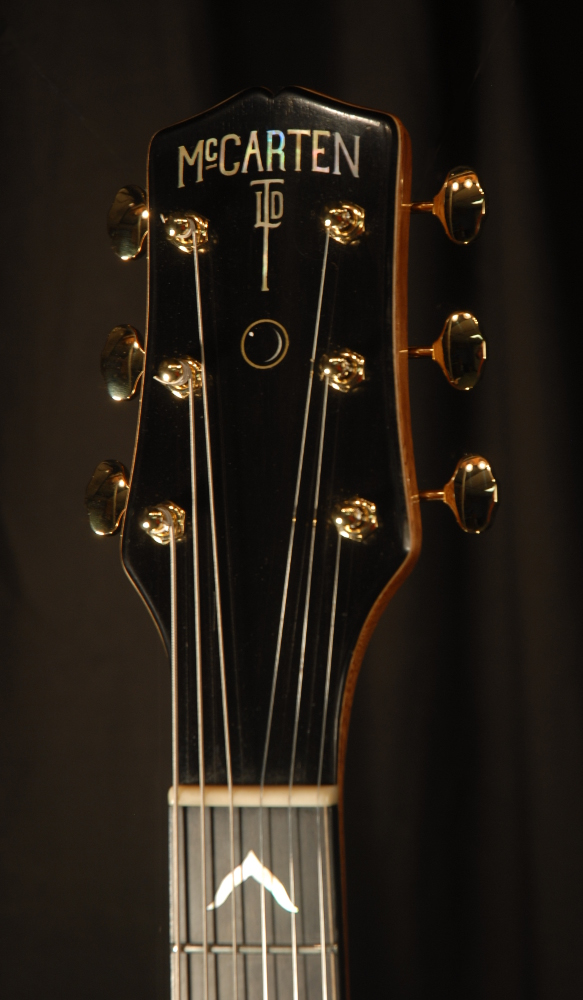 front view of the headstock of michael mccarten's DC13 double cutaway electric guitar model
