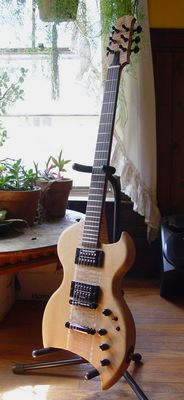 front view of a custom commisioned sitka spruce electric guitar made by michael mccarten