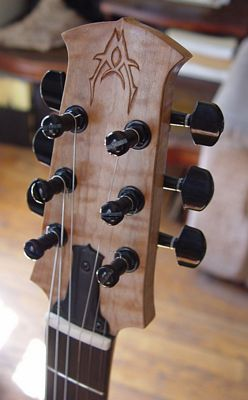 front view front headstock of a custom commisioned sitka spruce electric guitar made by michael mccarten