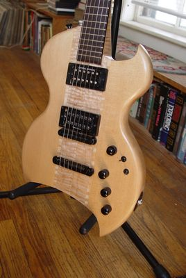 front view of the body of a custom commisioned sitka spruce electric guitar made by michael mccarten